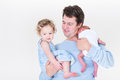 Young father holding toddler girl and newborn baby Royalty Free Stock Photo