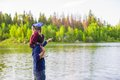 Young father and little adorable girl fishing on Royalty Free Stock Photo