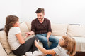 Young father playing with two beautiful sister daughters Royalty Free Stock Photo