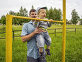 Young father and son years at the old stadium in village Royalty Free Stock Photography