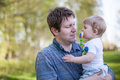 Young father and sweet baby boy in spring forest Royalty Free Stock Photos