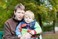 Young father and toddler boy in autumn park Royalty Free Stock Images