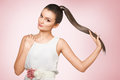 Young femail with healthy shining brown hairs put in pony tail Royalty Free Stock Photography