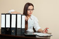 Young female accountant hugs documents folders Royalty Free Stock Photo