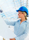 Young female architect holding blue prints Stock Photography