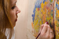 Young female artist painting landscape in her studio Stock Photos