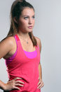 Young female in athletic attire with long brown hair ponytail wearing looking away Royalty Free Stock Images