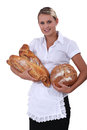 Young female baker holding some bread Stock Photography