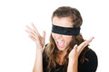 Young female with blindfold black screaming isolated on white Stock Photo