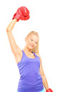 Young female boxer gesturing victory isolated on white background Stock Images