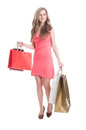 Young female carrying shopping bags on white background Royalty Free Stock Image