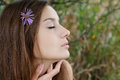 Young female closeup eyes closed profile of gorgeous with and flower in her hair Stock Images
