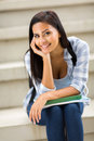 Young female college student sitting outdoors gorgeous Stock Images