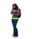 Young female college student talking on phone a a white background Stock Photos