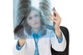 Young female doctor examining an x ray image isolated Royalty Free Stock Photos