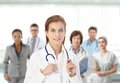 Young female doctor in front of medical team Royalty Free Stock Photo