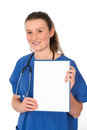 Young female doctor is pointing to white signboard Royalty Free Stock Photos