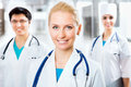 Young female doctor portrait of a sitting in front of his team and smiling Royalty Free Stock Photography