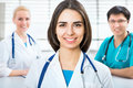 Young female doctor portrait of a sitting in front of his team and smiling Royalty Free Stock Photo
