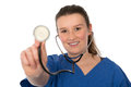 Young female doctor showing the stethoscope Royalty Free Stock Photos
