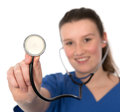 Young female doctor showing the stethoscope Stock Images