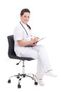 Young female doctor sitting over white background with folder Royalty Free Stock Photos