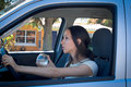 Young female driving under the influence of alcohol not looking at the camera Royalty Free Stock Images