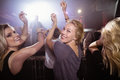 Young female friends dancing at nightclub Royalty Free Stock Photo