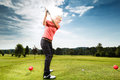 Young female golf player course doing golf swing presumably does exercise Stock Photos