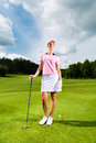 Young female golf player on course she presumably does exercise Stock Photo