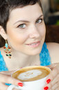 Young female having a cup of coffee Royalty Free Stock Image