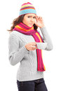 Young female having a headache and holding a cup of tea Royalty Free Stock Photography