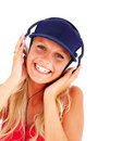 Young female hearing music on the headphones Royalty Free Stock Photos