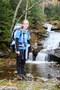 Young female hiker and river cascade Royalty Free Stock Photography