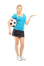Young female holding a soccer ball and gesturing full length portrait of isolated on white background Stock Photo