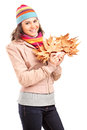 Young female holding tree leaves Royalty Free Stock Photos