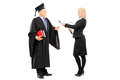 Young female interviewing mature man in graduation gown full length portrait of men isolated on white background Royalty Free Stock Photos
