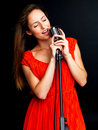 Young female jazz singer singing with retro mic Royalty Free Stock Photos