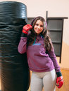 Young female kickboxer posing near punching bag Royalty Free Stock Photo