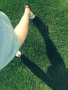 Young female legs dancing on the grass Royalty Free Stock Photo