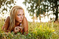 Young female lying on grass Royalty Free Stock Photography