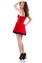 Young female model posing in red mini dress stock photography concept for usage Stock Images