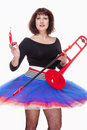 Young female musician with red trombone dancing isolated on white Stock Image