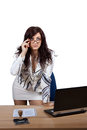 Young female office worker standing behind a desk with a stern look Stock Photography