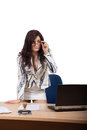 Young female office worker standing behind a desk with a stern look Royalty Free Stock Image