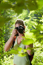 Young female photographer hiking in forest Royalty Free Stock Photography