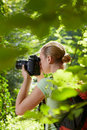 Young female photographer hiking in forest Stock Image