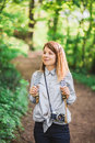 Young female photographer in nature Royalty Free Stock Photo