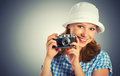 Young female photographer with retro camera happy in a hat Royalty Free Stock Photos