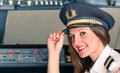 Young female pilot ready for takeoff smiling Royalty Free Stock Images